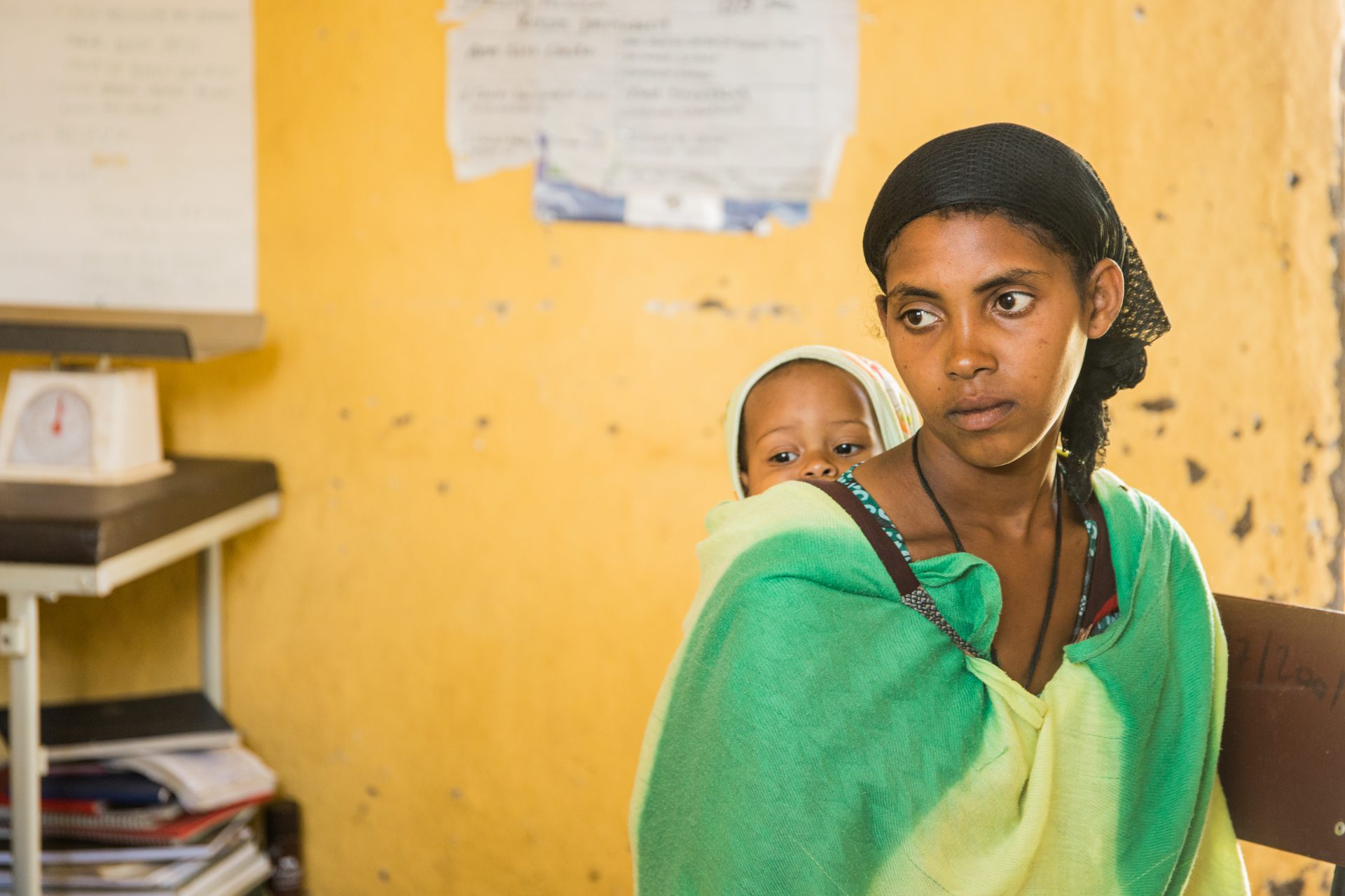 Yeshiwork Anteneh, 18, and her one year old son waiting for treatment at Yiraber Health Centre, West Gojjam, Ethiopia. ©WaterAid/Genaye Eshetu