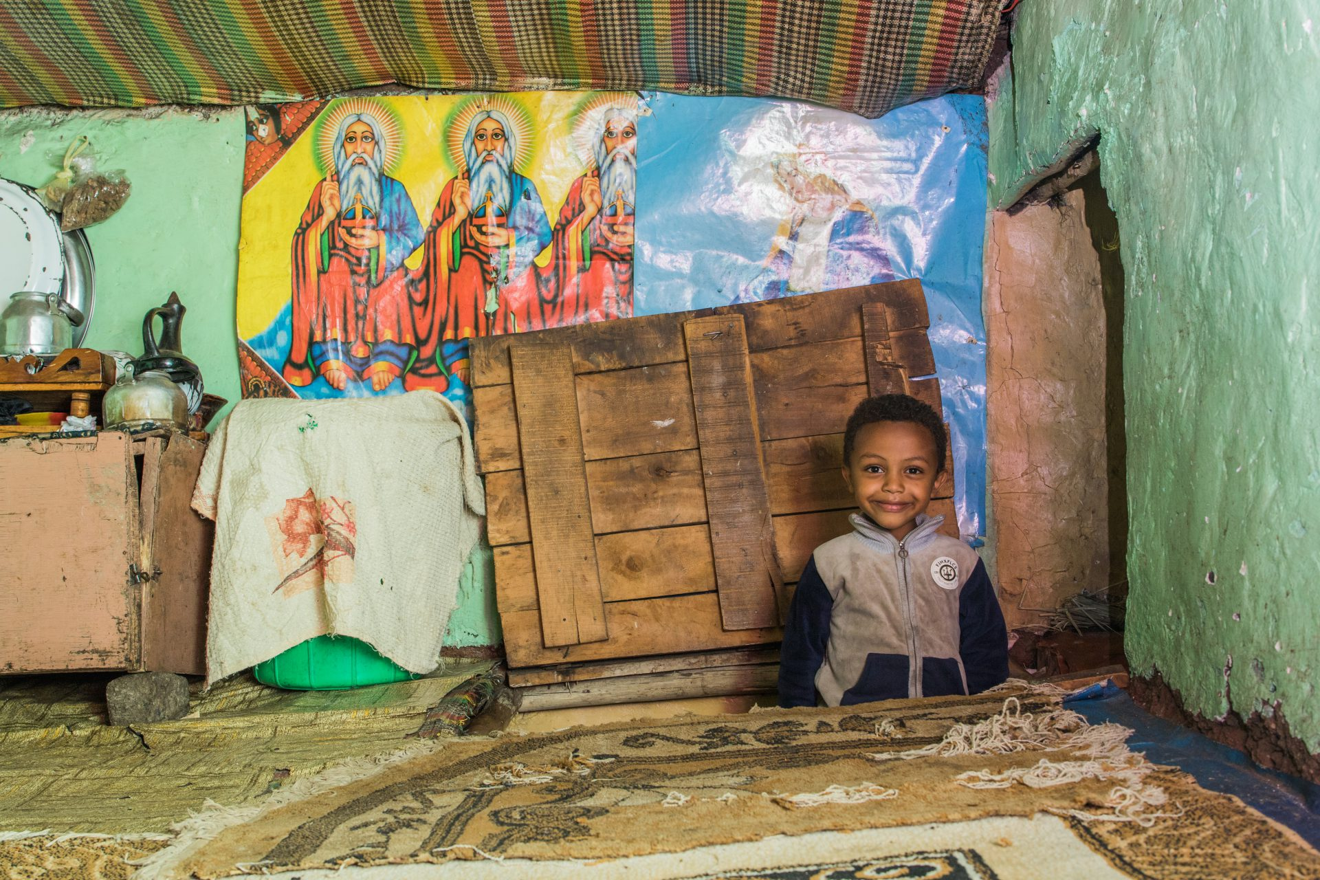 A child peeking into a roof bedroom, Addis Ababa, Ethiopia.